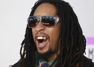 Rap artist Lil' Jon shows off his adorned teeth as he arrives at the 2011 American Music Awards in Los Angeles